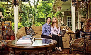 Joel and wife in their house